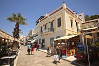 Tourists walking in the main street at the old town Chora in front of the Italian style buildings, Naxos, Cyclades Islands, Greek Islands, Greece, Eur...