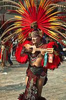Indigenous dancer in traditional costumes during the Virgen de Guadalupe Festival near Basilica Guadalupe in Mexico City, Mexico, Central America