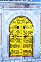 Spiked wooden door in the medina. Tunis city. Tunisia, Africa.