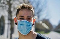 Caucasian male with medical masks as a defense against a virus. Coronavirus concept.