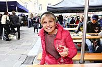 Woman at a wine festival in Innsbruck, Austria.