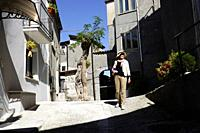 Woman, 69, in a street of Mormanno, Calabria, Italy.