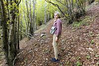 Woman in a beech tree forest nearItaly.