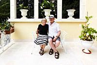 A couple on a terrace in Martina Franca, Puglia, Italy.