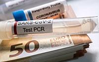 Coronavirus vial on euro banknotes, conceptual image.