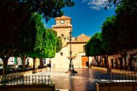 Front view of Santa Maria Parish Church and the central square in Nijar, Spain.