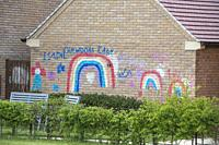 Colourful rainbow and thank you messages painted on a brick wall during the Covid19 pandemic lockdown.