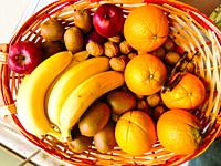 Basket of fresh fruit and walnuts.
