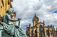 David Hume statue and St Giles´ Cathedral, or the High Kirk of Edinburgh, Royal Mile, High Street, Old Town, Edinburgh, Scotland, United Kingdom, Euro...