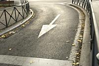 Curve street with traffic sign, city of Madrid, Spain