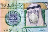 COVID-19 coronavirus in Gulf, 1 Riyal money bill with face mask. Coronavirus affects global stock market. World economy hit by corona virus outbreak a...