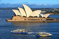 Sydney Opera House and public ferry and whale watching boats, Sydney, New South Wales, Australia.