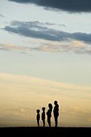 Silhouette of a Family on the beach.