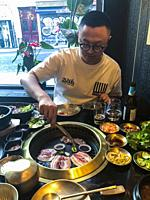 paris, France, People Sharing Meals at Table, Grilling Food, in Korean Restaurant in Belleville Neighborhood ´Gangnam´. Chinese Tourist, (Model Releas...