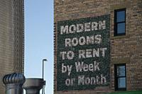 Canada, Alberta, Calgary. Old fashioned sign painted on the side of brick building, advertising rooms to rent.