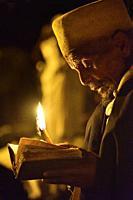 Ethiopia, Lalibela, World Heritage Site, Timkat festival, Night vigil, Christian devotee in prayer.