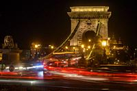 Chain Bridge at night with traffic, Budapest, Central Hungary, Hungary.