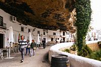 The famous Cuevas del Sol street. Street with dwellings built into rock overhangs. Setenil de las Bodegas, Cádiz, Andalucía, Spain, Europe.