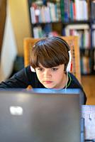 child attends online school lessons because of covid 19 quarantine.