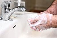 Close up of Senior man washing his hands using soap foam, Prevention from covid19, Coronavirus or Bacteria. Healthcare concept, 7 step hands wash .