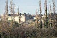 Magnificent round towered gateway and crenellated perimeter wall of Saint Andre Fortress through the trees on a sunny Autumn day, Villeneuve, Provence...
