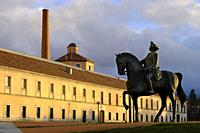The statue of Charles III, work of the artist Ramiro Ribas, in front of the Royal Glass Factory of La Granja in Real Sitio de San Ildefonso, province ...