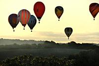 Hot air balloons in flight participating in the XXI FAI Europeans hot air balloon championship 2019, Spain, Balearic Islands, Mallorca.