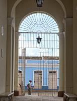 Beggar waits outside the Church of the Holy Trinity in UNESCO World Heritage Trinidad, Cuba.