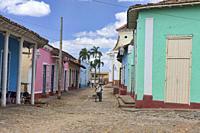 Bicyclist in UNESCO World Heritage Trinidad, Cuba.