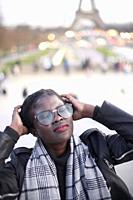 woman feeling inner world in Paris, listening to sound of city
