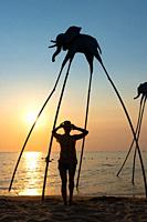 Silhouettes of elephants in Sunset Sanato beach, Phu Quoc.