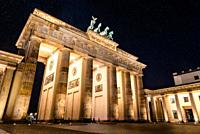 Low angle view of the Brandenburg Gate in Berlin at night with stars in sky. Germany.