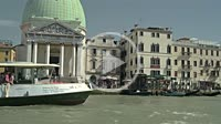 Public ferries with tourists sailing on Grand Canal. Venezia. Italy.