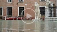 "Naval army cadets walking trough the so called """"acqua alta"""" high tide nearby the Arsenale. Venezia. Italy."