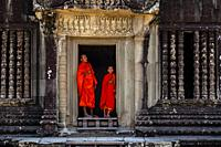 Novice Buddhist Monks At Angkor Wat, Siem Reap, Siem Reap Province, Cambodia.