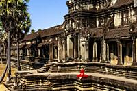 A Visitor Poses For A Photo At Angkor Wat Temple Complex, Siem Reap, Siem Reap Province, Cambodia.