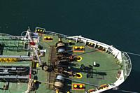 Top view of winches and ropes on bow of fuel oil bunker vessel, Piraeus port, Athens, Greece.