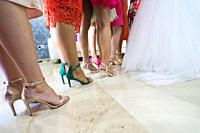 Detail of the heels of the bride´s friends on the wedding day