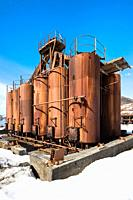 Rusted old metallic tanks and machinery, Former Grytviken whaling station, King Edward Cove, South Georgia, South Georgia and the Sandwich Islands, An...