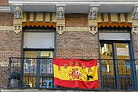 View of a Spanish flag in a street of Chamberi quarter. Madrid city, Spain. May, 2020