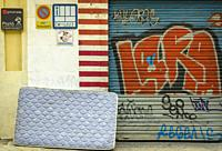 View of a mattress in a street of Chamberi quarter. Madrid city, Spain. May, 2020