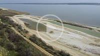 Aerial view, flying over the salty sands of the litoral zone on Kuyalnik Liman. Camera moving forwards above coastline Kuyalnik Estuary, Odessa Oblast...