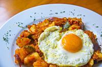 Pisto with fried egg. La Mancha, Spain.