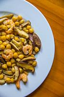 Chickpeas with prawns and mushrooms.