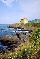 Chapel and coastline. Urdaibai Nature Reserve, Mundaka, Vizcaya province, Basque Country, Spain.