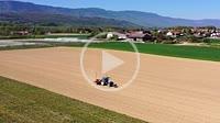 Tractor doing field work in spring, Chavanne-de-Bois, Nyon, Canton of Vaud, Switzerland