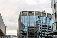 Low angle view of modern architecture office buildings in Castellana Avenue in Madrid against cloudy day.