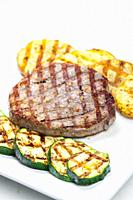 grilled tuna with potatoes and zucchini.