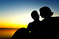 Silhouette of a wedding couple in the sunset of the Albufera de Valencia, Spain