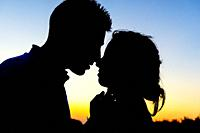 Silhouette of a wedding couple kissing in the sunset of the Albufera in Valencia, Spain